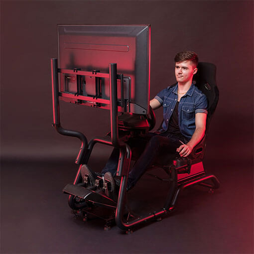 Men Playing Games on Racing Simulator Cockpit